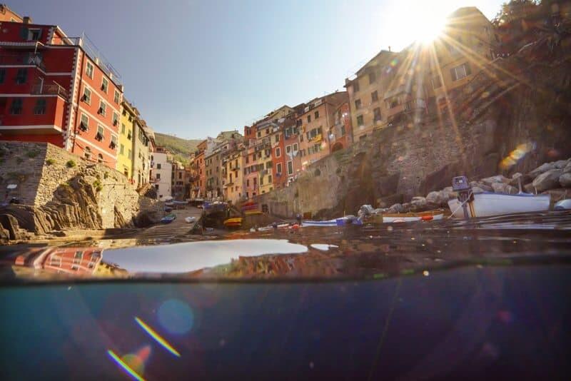 Morning light creeps over the colourful buildings of Riomaggiore, Cinque Terre.