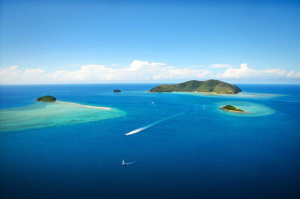 Flying past One&Only Hayman Island, Langford and Bali Hai on the way to the Great Barrier Reef.