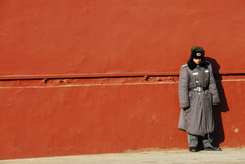 This guard at Beijing's Forbidden City with his grey uniform against the rich red wall. By composing him slightly right of centre it enhances the image and the effect of the contrasting colours.