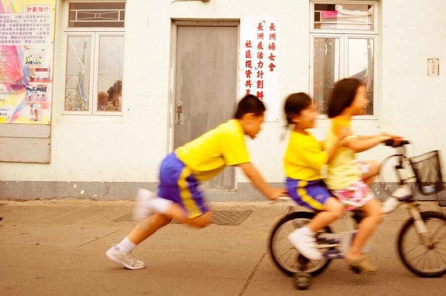 Cheung Chau Island, Hong Kong: This island is filled with bicycles and I wanted to capture a shot that showed this along with the happy nature of the people who lived there. I'd captured another shot but then these children rode past squealing with excitement on their way home from school.