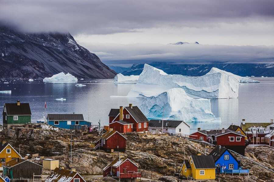 Massive icebergs and colourful houses in Uummannaq, Greenland