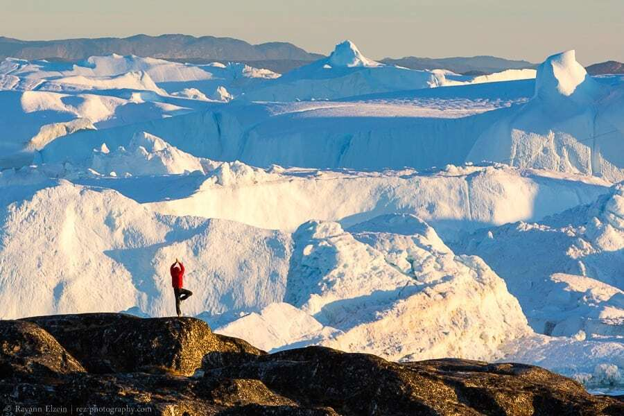 Yoga in front of the icebergs of the Unesco Ilulissat Icefjord