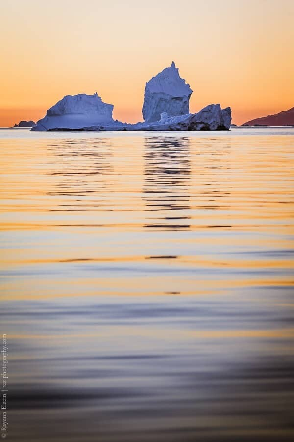 Iceberg and evening light in Uummannaq in West Greenland
